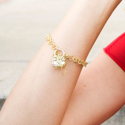 Alma & Co. Rose bracelet. Big links gold 14k electroplated chain with a charm clasp and safety chain.