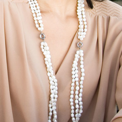 Alma & Co. Elsa necklace. Three strands of genuine white freshwater pearls with a slide lock clasp in silver necklace